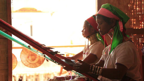 Padaung (Karen) tribe women weave on traditional device Footage