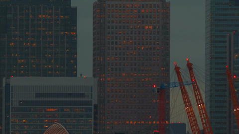 Ultra closeup tilt of the Canary Wharf financial center and Thames Barrier in Lo Footage