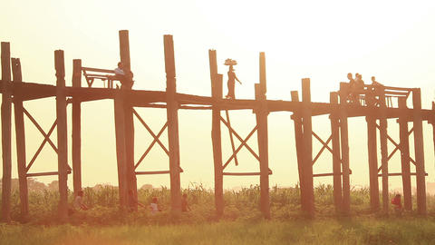 Silhouettes of people on famous U Bein Bridge at sunset in Amarapura, Myanmar Footage