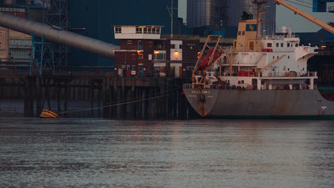 A large cargo ship offloads raw material to the Tate Lyle sugar factory in Londo Footage