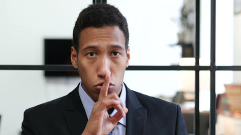 Gesture of Silence by Black Businessman, Finger on Lips Footage
