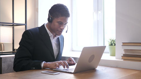 Black Businessman Attending Customer Call, Call Center Live Action