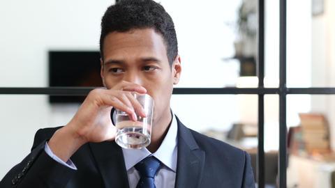 Portrait of Black Businessman Drinking Water Footage