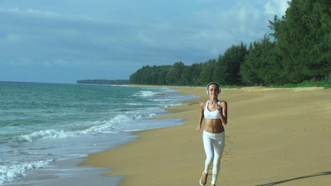 Sport Woman Running On Beach On Sunny Summer Day Footage