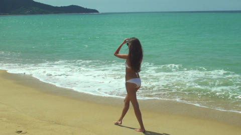 Young Beautiful Girl Walking On The Beach Footage