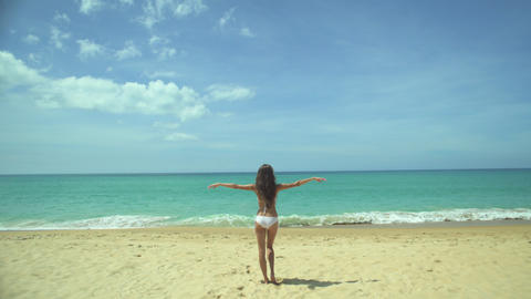 Young Woman Raises Her Arms Up On The Beach Footage