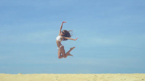 Happy Free Girl Jumping On The Beach Footage