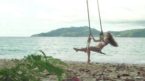 Happy Girl On A Swing On The Beach Footage