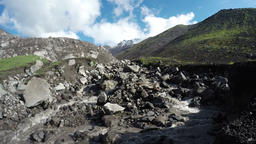 Creek flowing from snowfields on slopes of volcano Footage