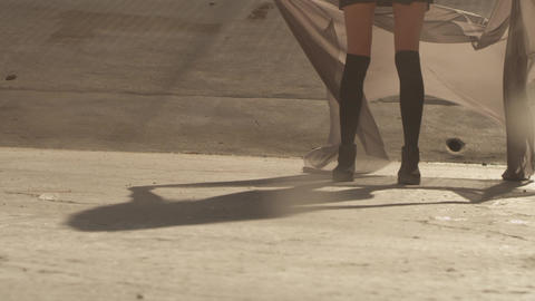 Beautiful girl with the waving fabric positing, dancing, running, walking in the Footage
