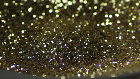 Golden glitter dancing, shivering on black loud speaker. Golden glitter explodin Live Action