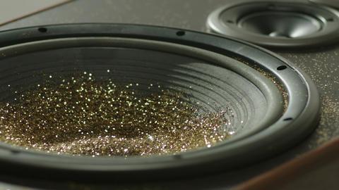 Golden glitter dancing, shivering on black loud speaker. Golden glitter explodin Footage