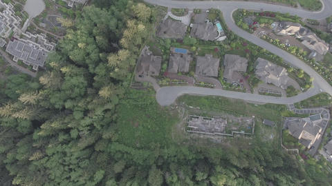 Aerial top down view of a residential area with houses, streets, and parks Footage