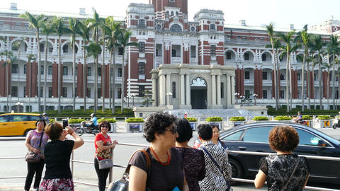 People pose for the Presidential Office Building in Taipei Live Action