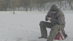 Fisherman catches fish in the winter Footage