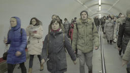A crowd of people who go through large underpass Footage