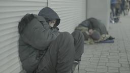 Beggar homeless man sleeps sitting Footage