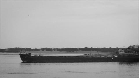 Barge is floating on the river