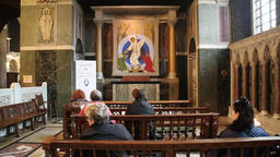 Congregation singing in a side chapel at Westminster Cathedral London UK Footage