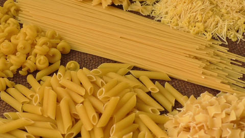 Variety of types and shapes of Italian pasta Footage