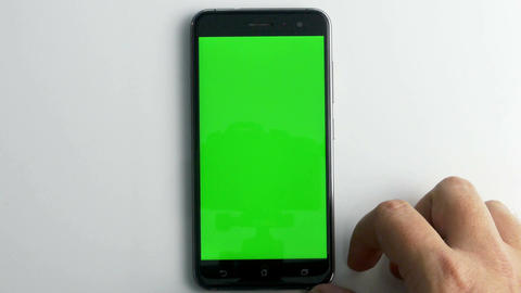 Move phone into position green screen on white Live Action