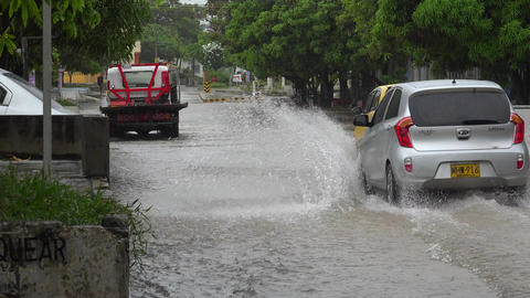 Tow Truck And Cars On Flooded Street