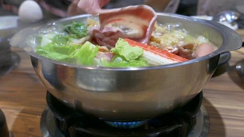 putting meat in hotpot 1 Live Action