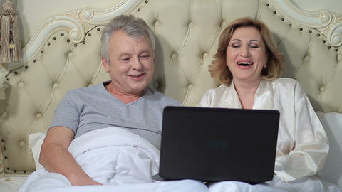Senior couple connected with family on internet Footage
