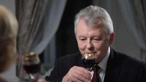 Mature man drinking glass of red wine Footage