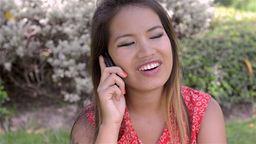 Young Woman Talking on her Mobile Phone - Dolly Stock Video Footage