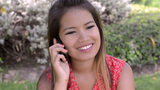 Young Woman Talking On Her Mobile Phone - Dolly stock footage