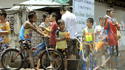 Songkran Water Fight With Passing Motorbikes and Bicycles Stock Video Footage