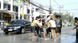Songkran Water Fight With Girls on a Bicycle Stock Video Footage