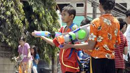 Children Spraying Passing Motorbikes During Songkran... Stock Video Footage