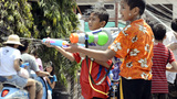 Children Spraying Passing Motorbikes During Songkran Festival Footage