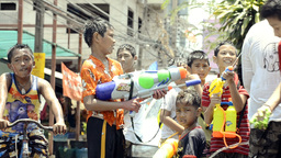 Boy With Water Pistol In Songkran Water Fight Stock Video Footage