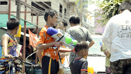 Boy With Water Pistol In Songkran Water Fight Stock Video Footage