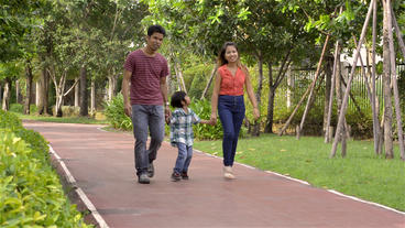Happy Asian Family Walking in the Park Stock Video Footage