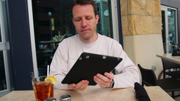 Man Uses Tablet PC Footage