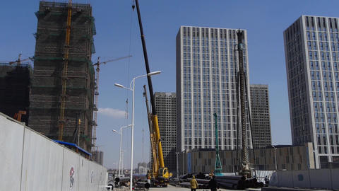 High crane & builder working in Construction site Stock Video Footage