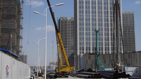 High crane & builder working in Construction site Footage