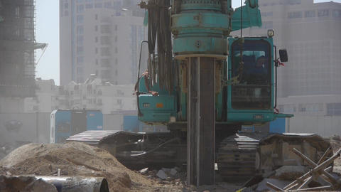 drill machinery drilling in land,Construction site Footage