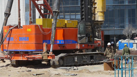 workman command heavy drill machinery moving in... Stock Video Footage