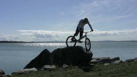 Trials Mountain Bikes Jumping On Rocks Stock Video Footage