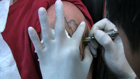 Tattooing Yellow Ink Stock Video Footage