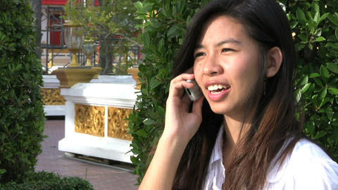 Thai Girl Talking On Cell Phone Footage