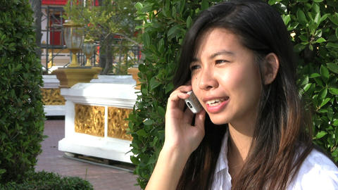 Thai Girl Talking On Cell Phone Stock Video Footage