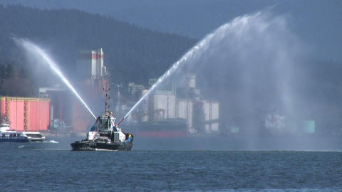 Tug Boat Spraying Water Backwards Stock Video Footage