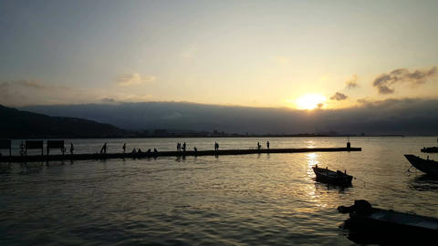 Sunset at the Tamsui river with view on Bali district Live Action