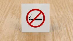 No smoking sign on wooden table Animation
